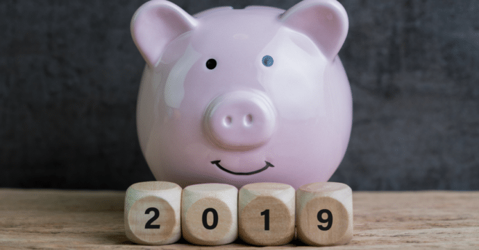 savings piggy bank with 2019 blocks