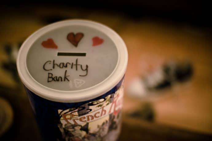 Photo of coin jar collecting money for charity for community involvement