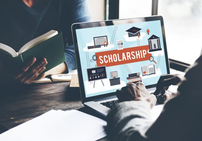 scholarship on computer, counselor, student, desk, book