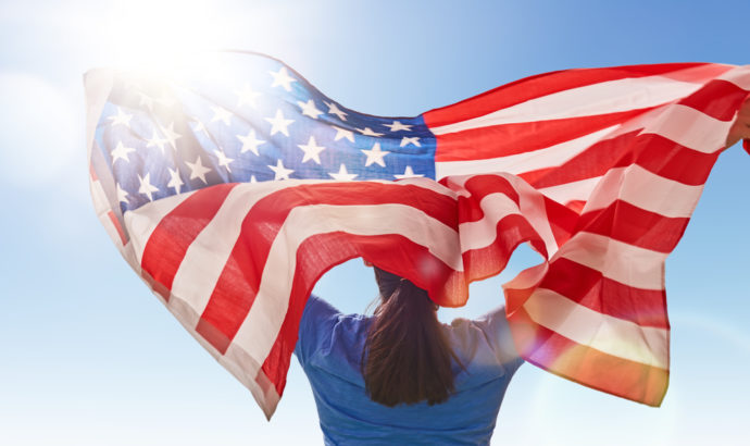 American Flag, Independence Day, July4th, Lady holding flying flag