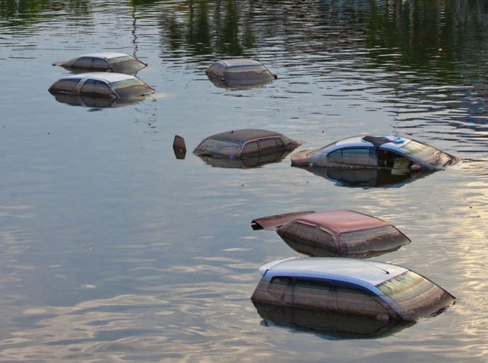 Flooded cars, underwater, rooftops of cars showing